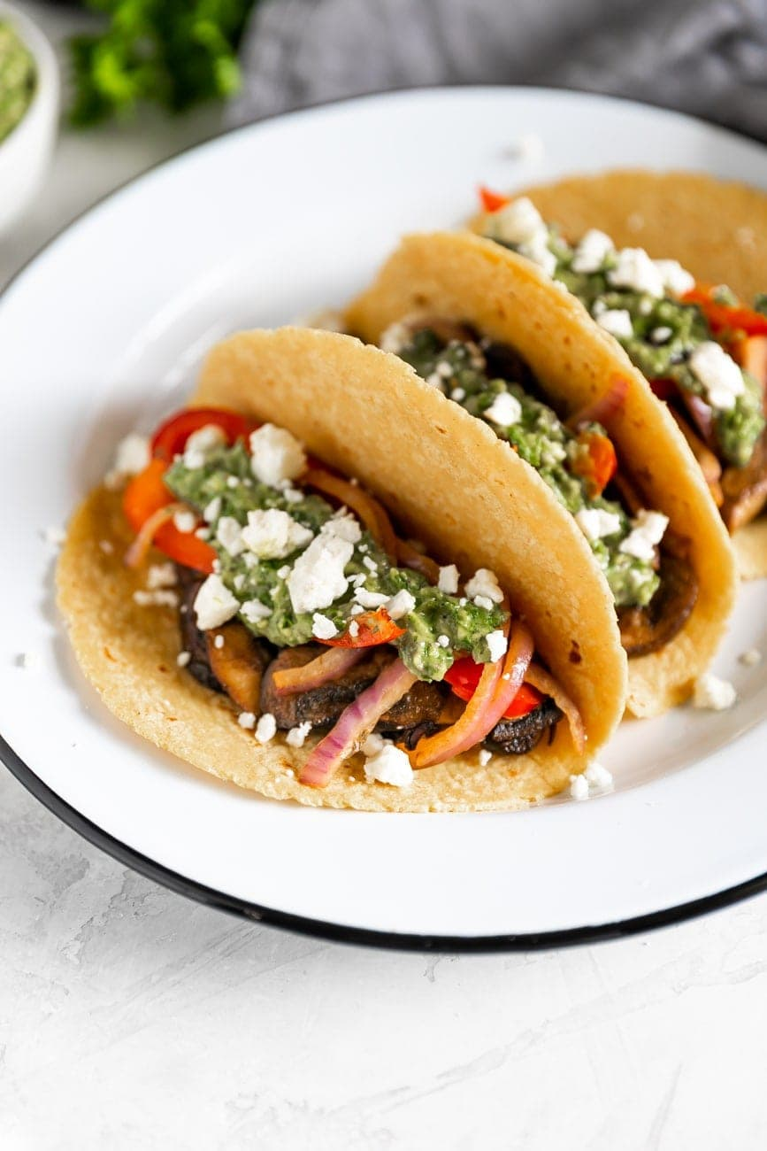 vegetarian tacos with mushrooms, peppers, onions, feta cheese