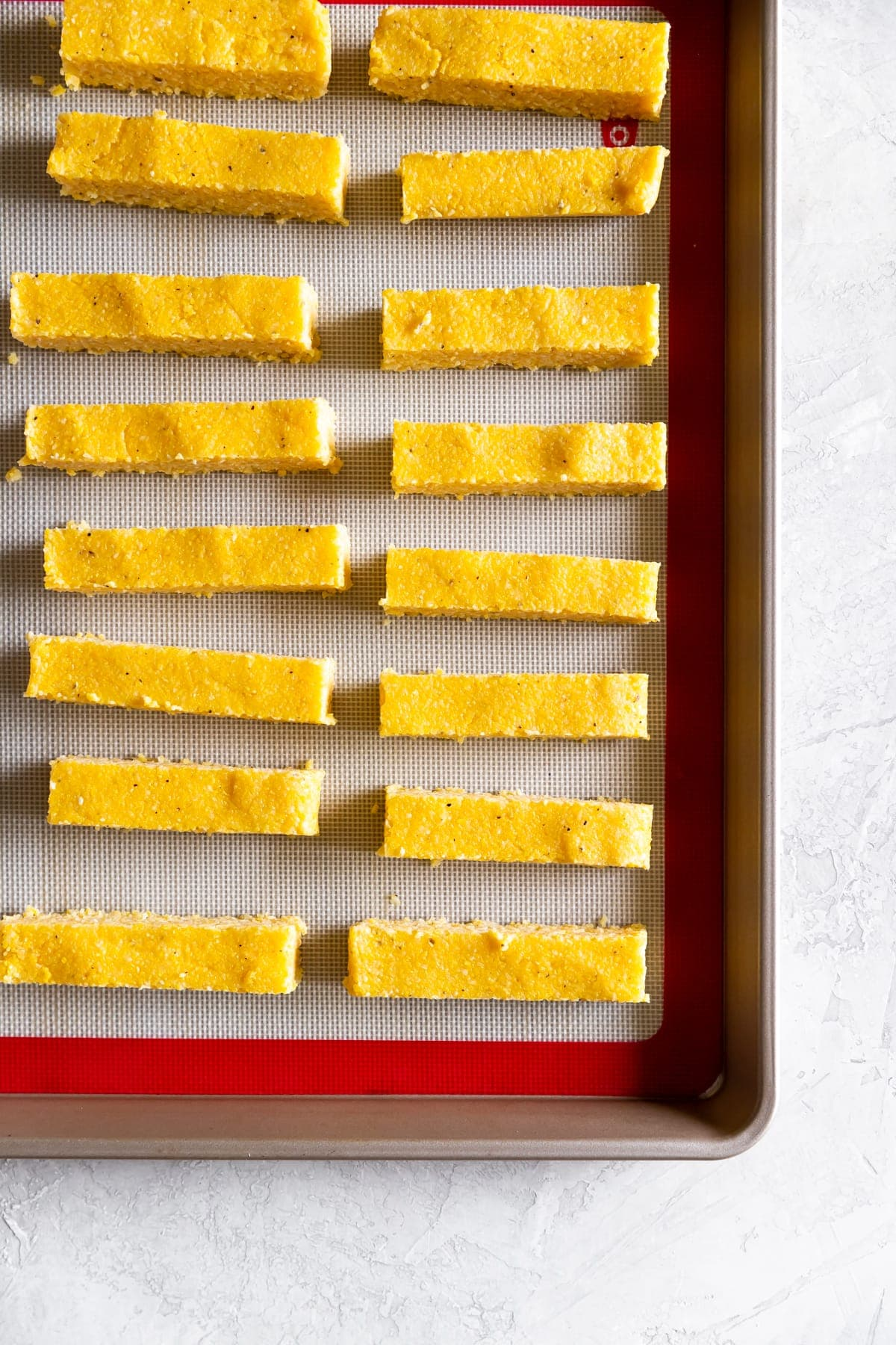cut up polenta on a baking sheet