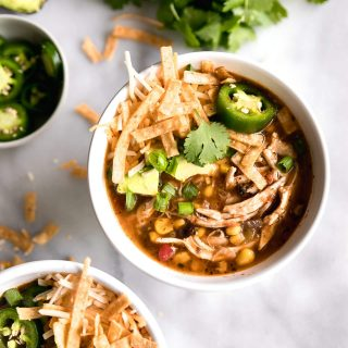 A spicy, flavorful, 30-minute chicken tortilla soup made with fire roasted tomatoes, shredded chicken breast, black beans, corn, avocado and spices!