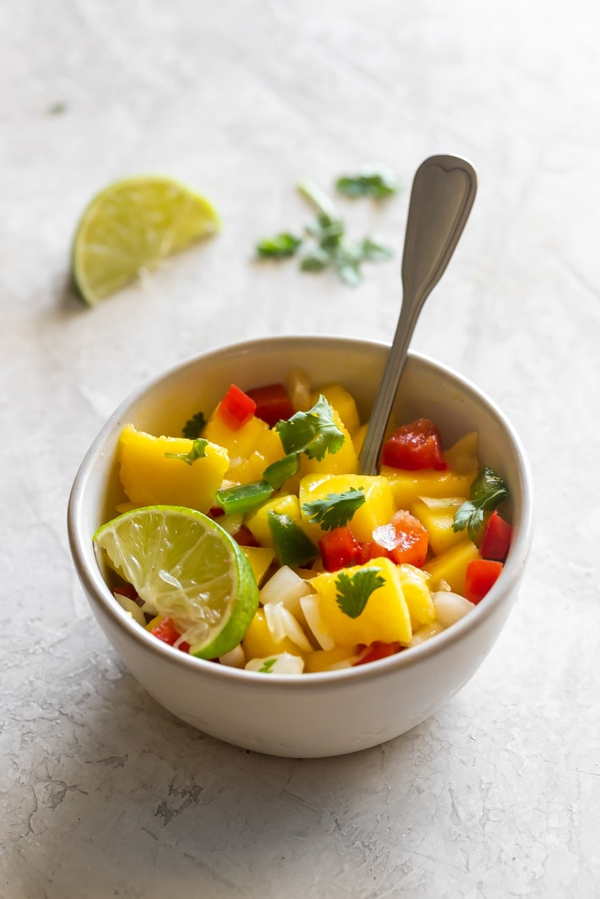 fresh mango salsa made with onion, red bell pepper, cilantro, jalapeño, lime juice