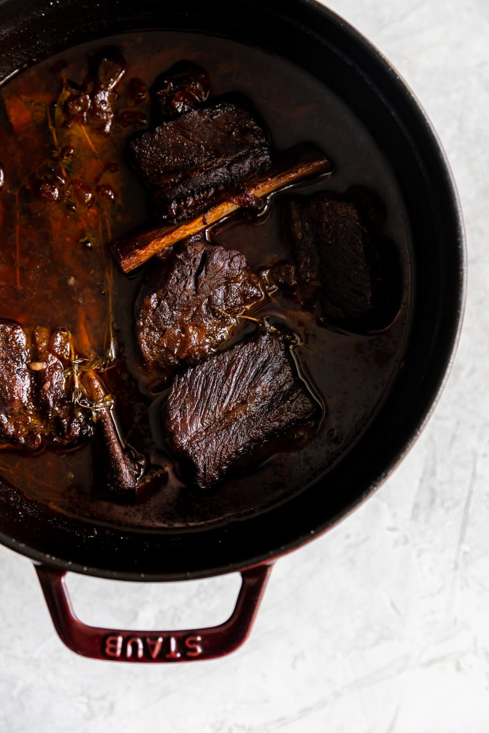 cooked red wine braised short ribs in a Staub Dutch oven