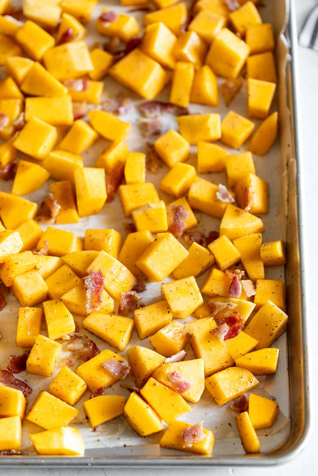 A simple savory roasted butternut squash with crisp pieces of bacon. A healthy, easy to make side dish made with just 3 ingredients!