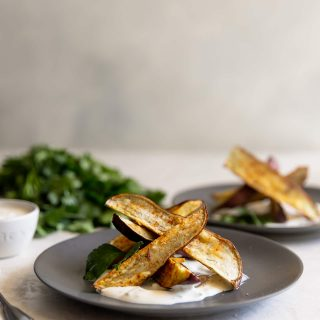 Japanese sweet potato fries, sprinkled with chili powder, salt, and pepper, roasted then served with a charred scallion creme fraiche. Perfect appetizer!