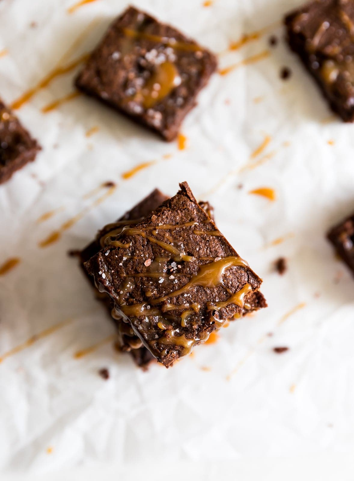 Chocolate brownies with caramel drizzled on top