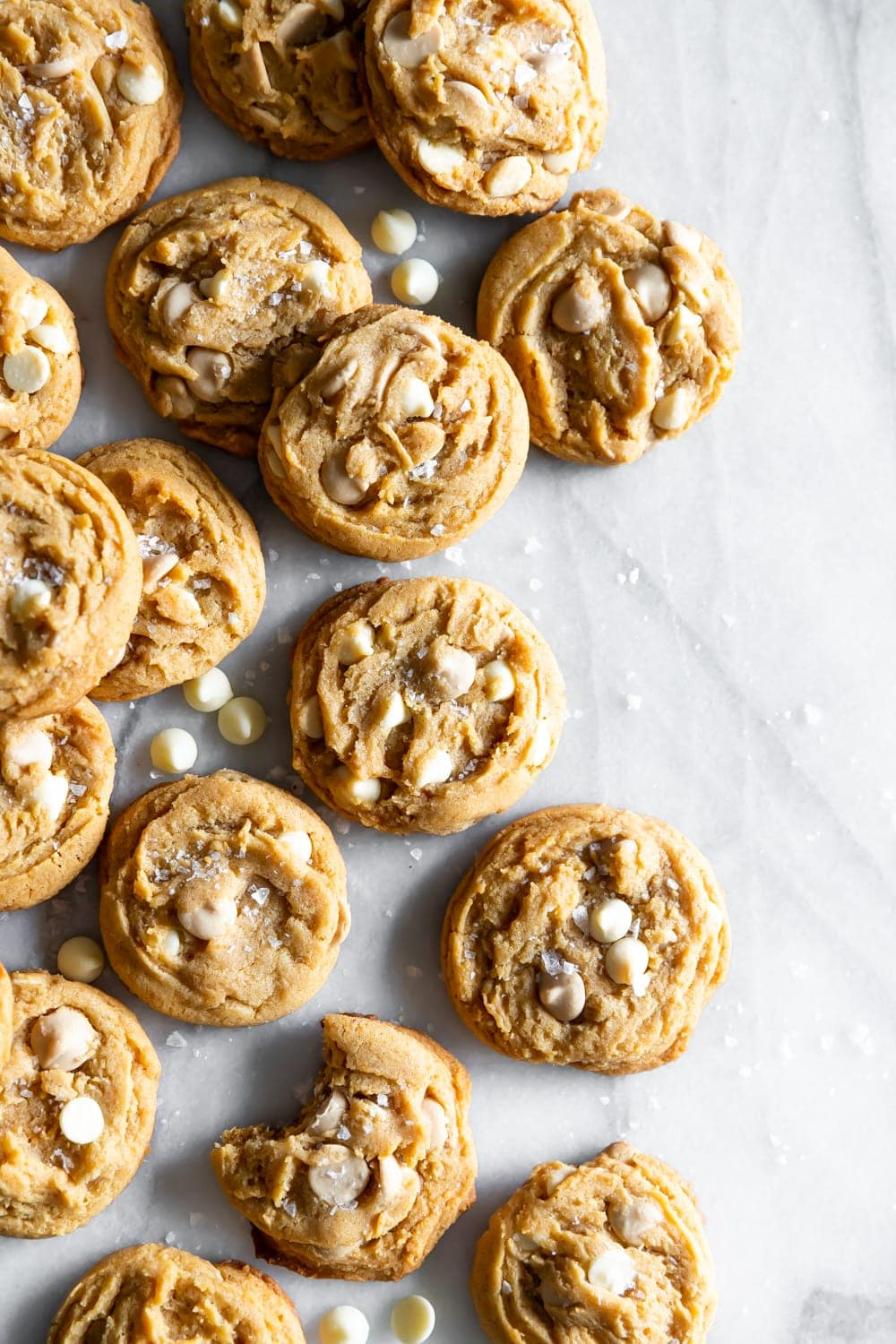 salted caramel white chocolate chip cookies on a marble slab