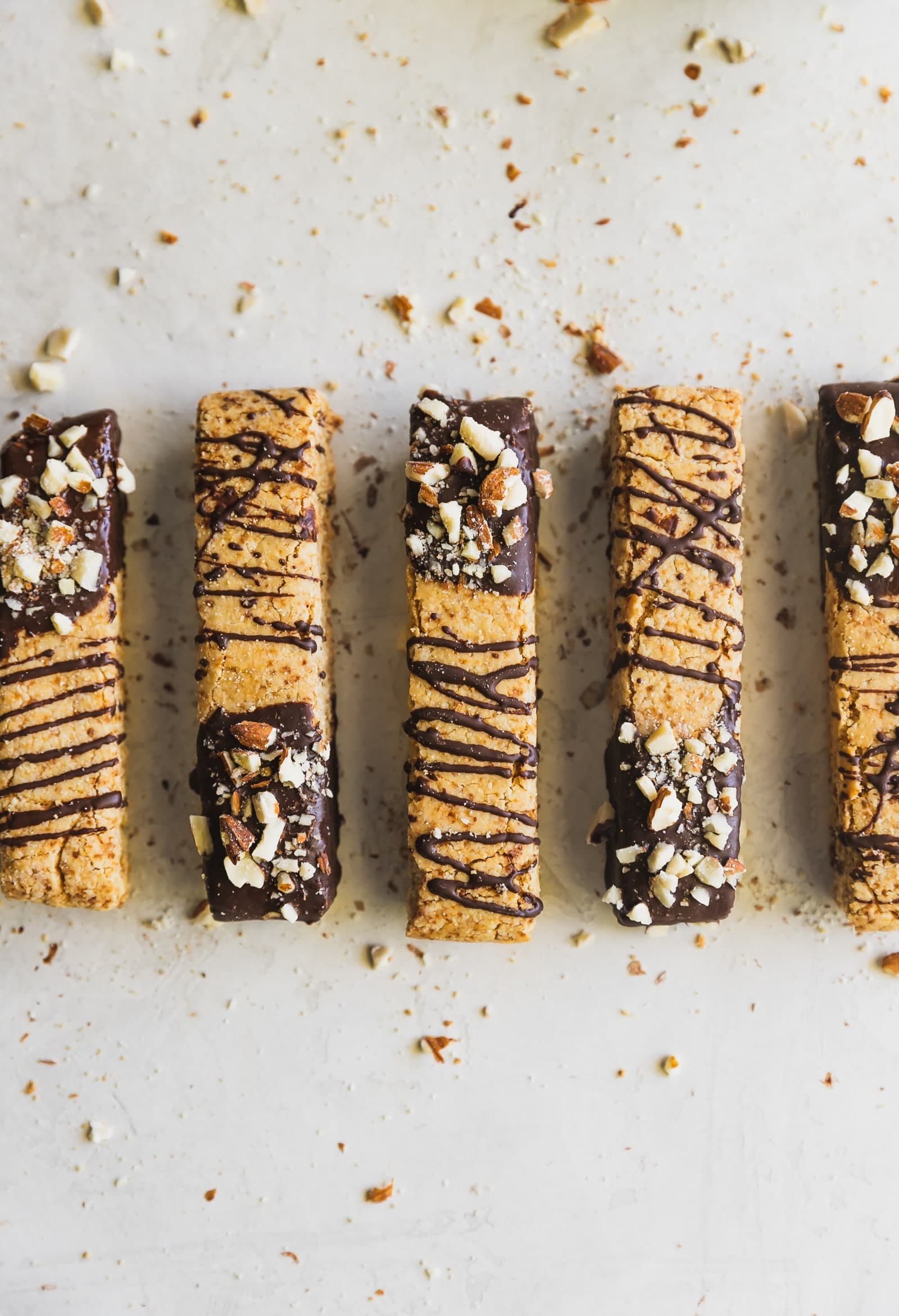 Dairy-free and grain-free almond biscotti dipped in melted dark chocolate and topped with chopped almonds. No better snack for any day of the week!