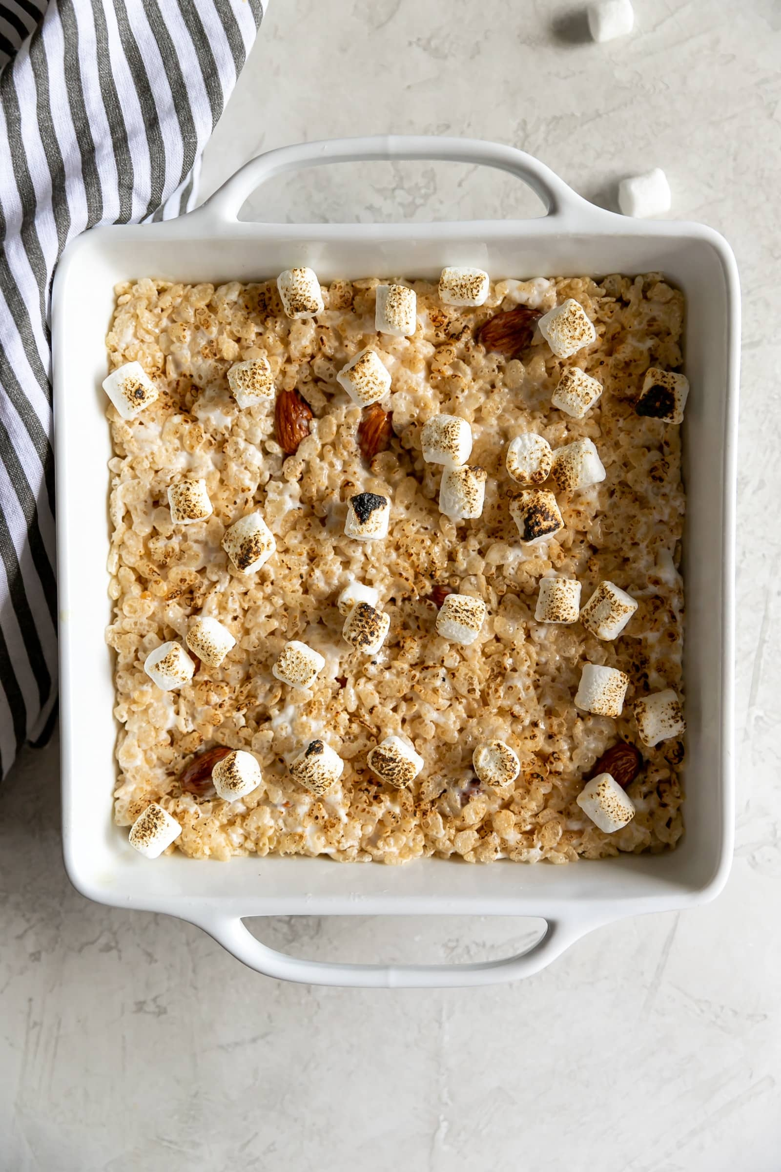 A sweet crispy classic treat with a smoky twist! Rice cereal, torched marshmallows, and smoked almonds come together to make Smoky Rice Krispie Treats.