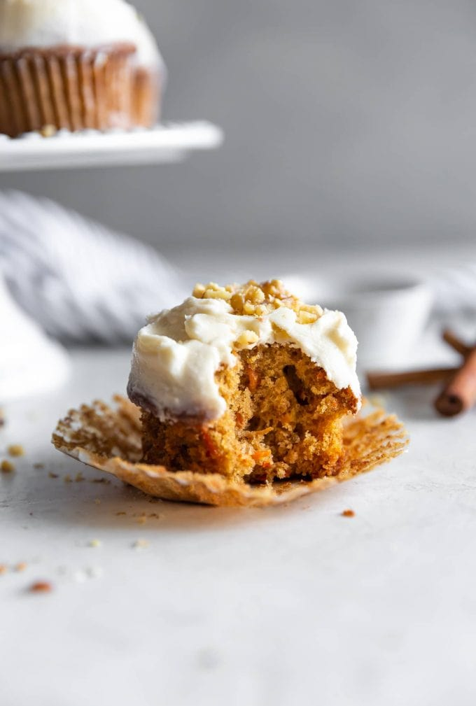 Easy-to-make cinnamon spiced, fluffy, moist carrot cupcakes topped with a heavenly brown butter frosting and chopped walnuts.