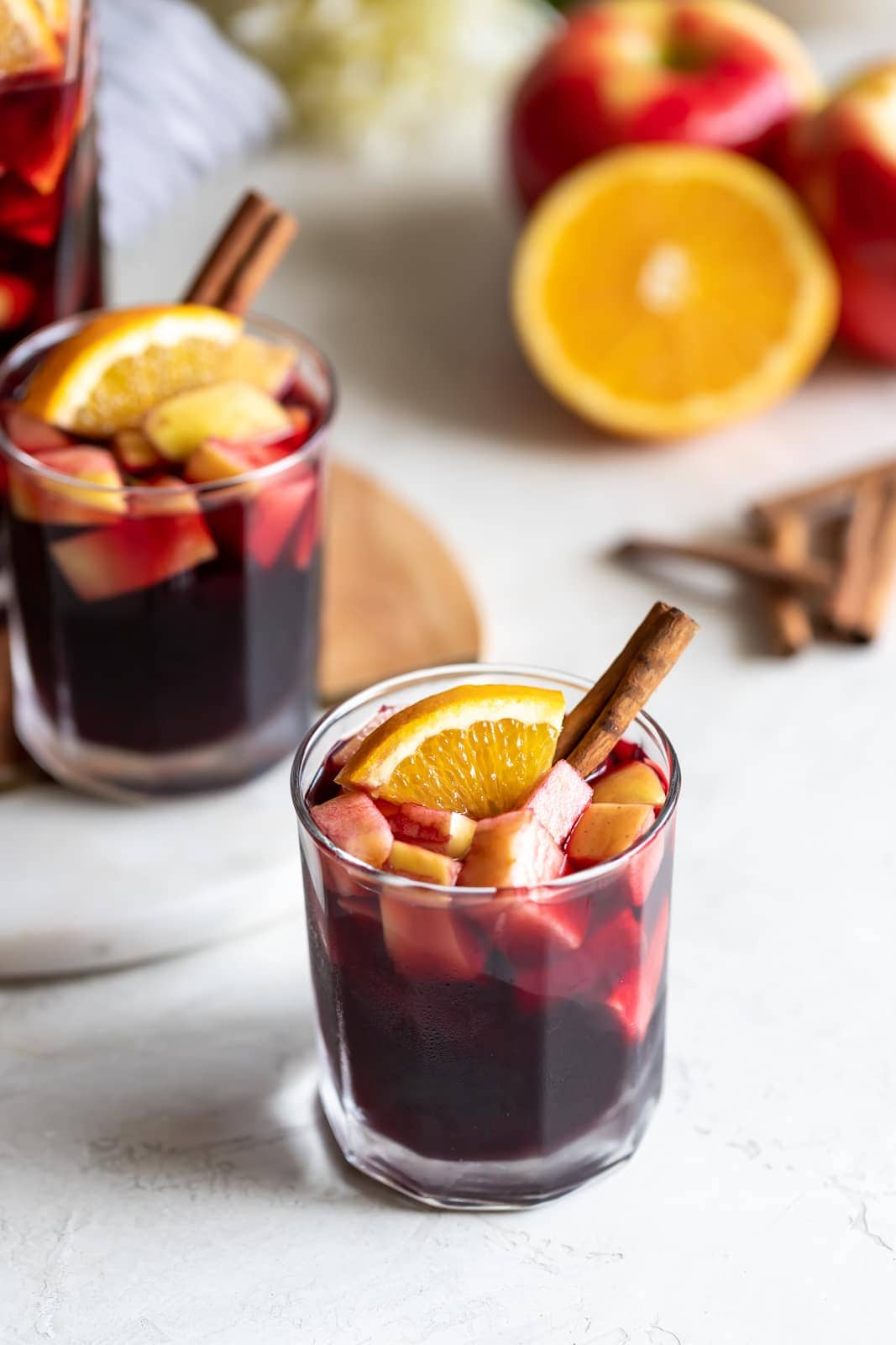 A deliciously fall-flavored red wine sangria made with pears, apples, sliced oranges and warm spices like cinnamon, ginger, and cardamom.