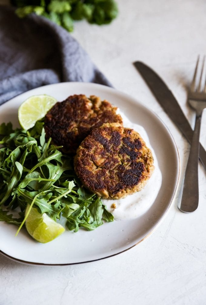 A delicious way to enjoy canned tuna! These spicy lime tuna cakes are made with garlic, onions, chili powder, fresh lime juice then served with a simple yogurt sauce and arugula salad.