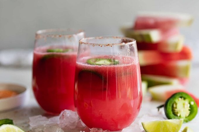 Spicy Tequila Watermelon Punch. Fresh cubed watermelon blended with tequila, lime juice, and sliced jalapeños in chili salt rimmed glasses. Refreshing drink for a hot day!