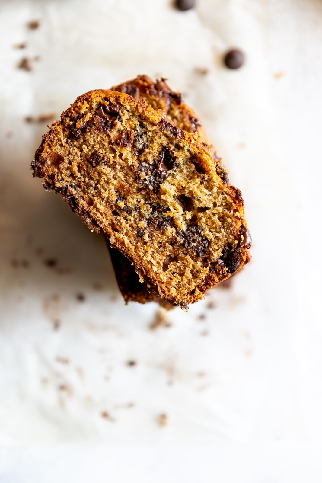 overhead view of slices of banana bread with melted chocolate chips