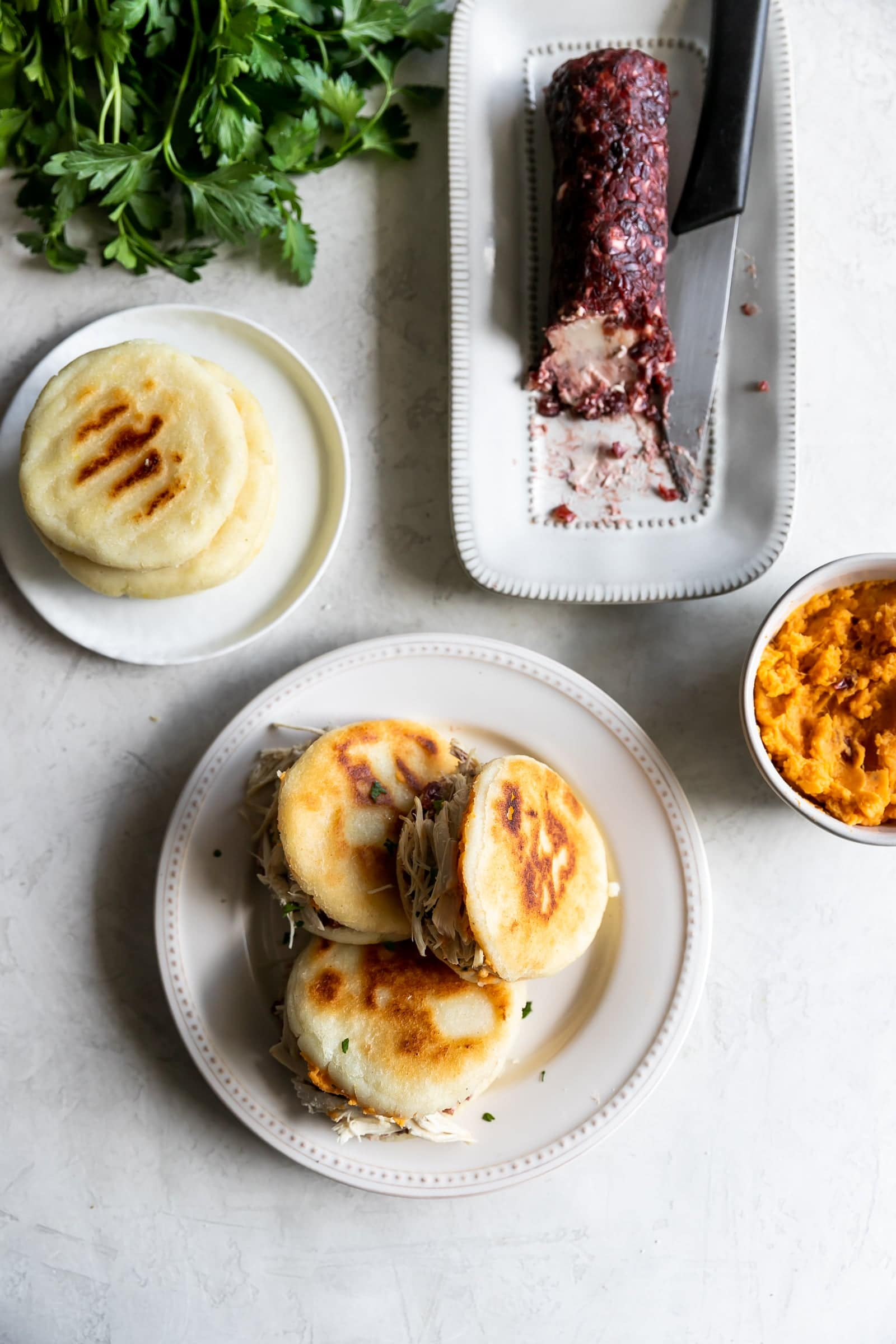 Easy-to-make arepas (pan fried corn cakes) made with homemade cranberry goat cheese and your favorite Thanksgiving leftovers!