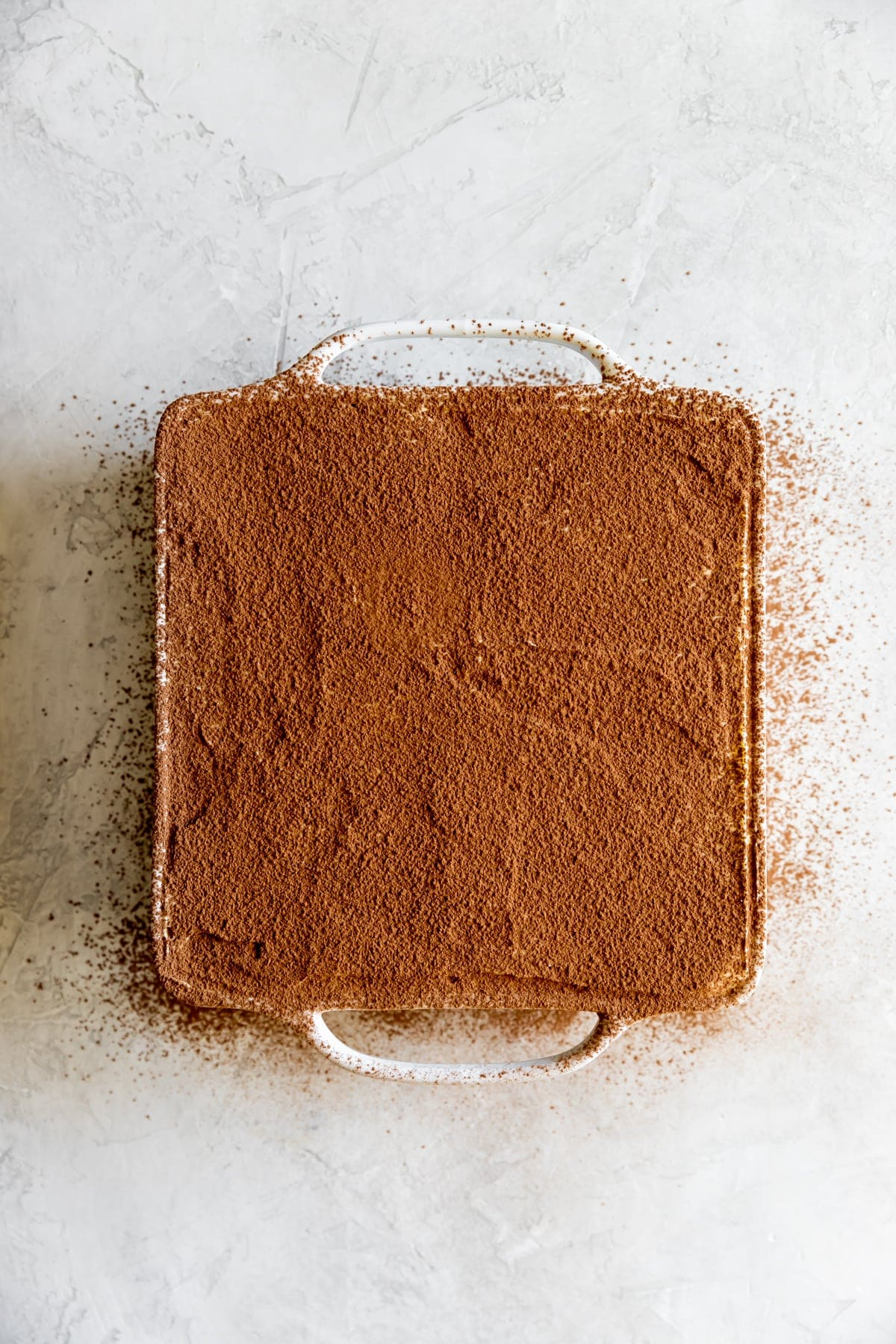 cocoa dusted over the tiramisu before serving