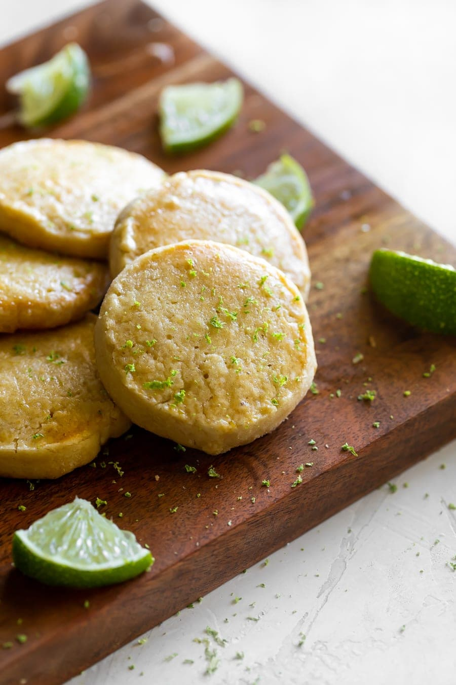 easy shortbread cookies on a cutting board with lime zest on top