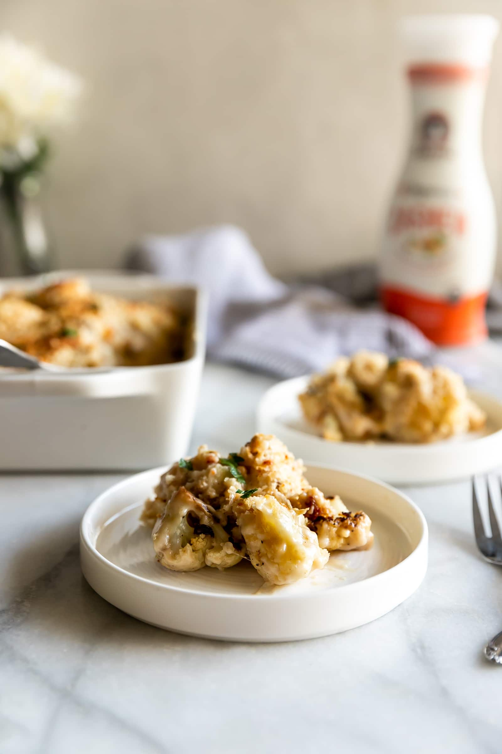 A deliciously creamy roasted cauliflower gratin made with a simple cashew cheese sauce then topped with a cheesy bread crumb topping.